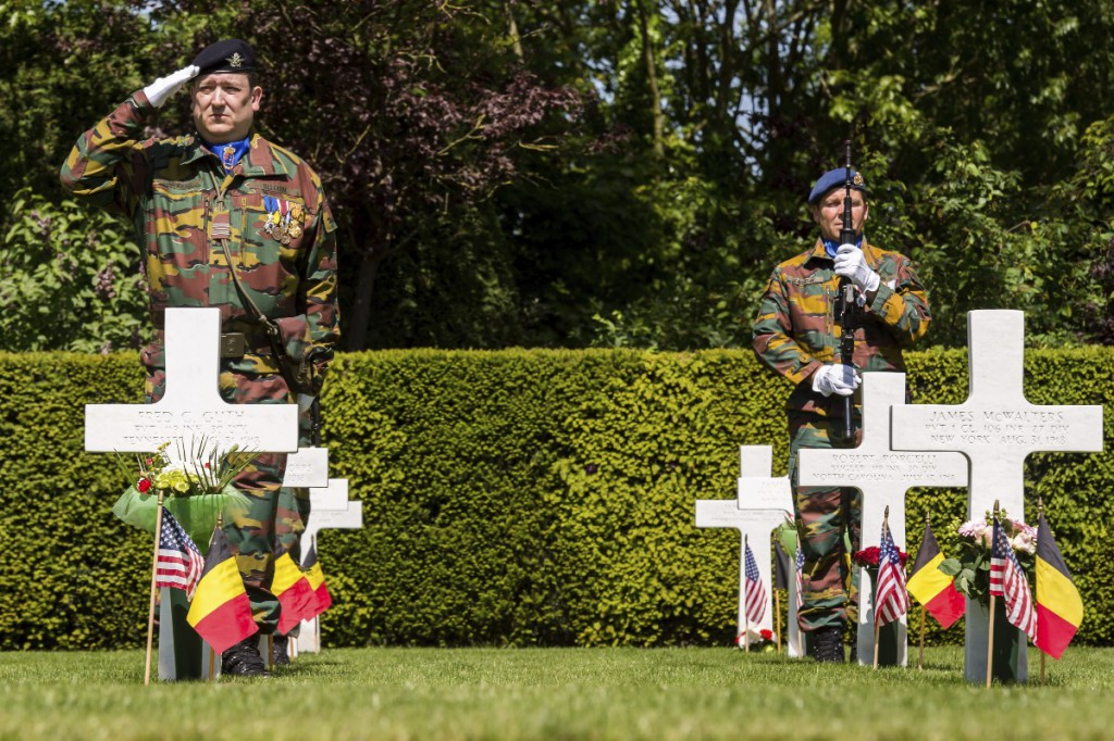 Belgian soldiers salute during a Memorial Day Ceremony at the Flanders Fields American Cemetery in Waregem, Belgium, on Sunday May 24, 2015. (AP Photo/Geert Vanden Wijngaert)